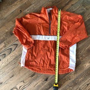 Nike men's wind breaker. Large.  Orange and white.